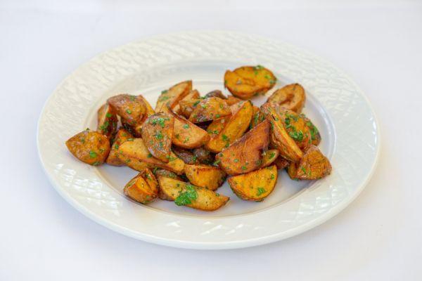 Молода картопля в тосканських травах
